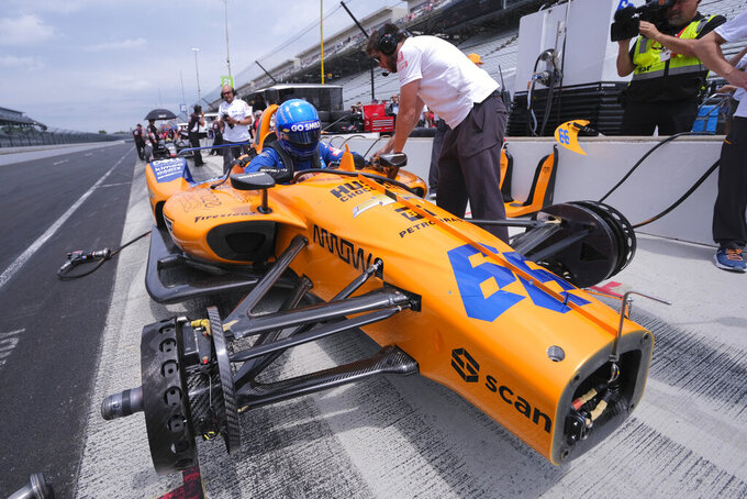 Fernando Alonso, of Spain, climbs into his car during practice for the Indianapolis 500 IndyCar auto race at Indianapolis Motor Speedway, Friday, May 17, 2019 in Indianapolis. (AP Photo/AJ Mast)