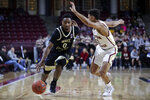 Wake Forest guard Brandon Childress (0) drives to the basket against Boston College guard Derryck Thornton, right, during the first half of an NCAA college basketball game in Boston, Wednesday, Nov. 6, 2019. (AP Photo/Charles Krupa)