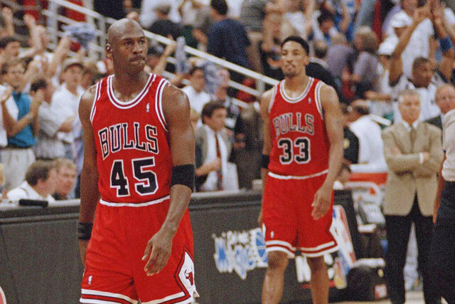 "FILE - In this May 7, 1995, file photo, Chicago Bulls guard Michael Jordan (45) and forward Scottie Pippen (33) walk back to the bench during a timeout in the closing seconds of an NBA basketball playoff game in Orlando. Pippen says he's talked with Jordan since ""The Last Dance"" documentary aired in the spring and downplayed any rift between the retired Bulls stars. (AP Photo/Robert Baker, File)"