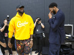Los Angeles Lakers NBA basketball LeBron James, left, shares a moment with Anthony Davis after a news conference introducing Davis at the UCLA Health Training Center in El Segundo, Calif., Saturday, July 13, 2019 (AP Photo/Damian Dovarganes)