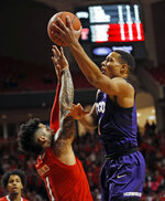 TCU's Desmond Bane (1) shoots the ball over Texas Tech's Brandone Francis (1) during the first half of an NCAA college basketball game Monday, Jan. 28, 2019, in Lubbock, Texas. (AP Photo/Brad Tollefson)