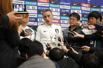 South Korean national soccer team head coach Paulo Bento answers a reporter's question upon his arrival after the soccer match against North Korea, at Incheon International Airport in Incheon, South Korea, Thursday, Oct. 17, 2019. North Korea held South Korea to a 0-0 draw Tuesday in a World Cup qualifying soccer match played in an empty stadium in Pyongyang, but specific details of the game weren't immediately available. South Korean soccer officials were unable to watch a telecast of the historic game at Kim Il Sung Stadium and South Korean spectators and media were denied entry. (AP Photo/Lee Jin-man)
