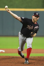 Washington Nationals starting pitcher Stephen Strasburg throws against the Houston Astros during the first inning of Game 6 of the baseball World Series Tuesday, Oct. 29, 2019, in Houston. (AP Photo/Mike Ehrmann, Pool)