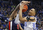 Kentucky's PJ Washington, right, shoots while pressured by Auburn's Chuma Okeke (5) during the first half of an NCAA college basketball game in Lexington, Ky., Saturday, Feb. 23, 2019.(AP Photo/James Crisp)