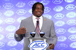 FILE - In this July 17, 2019, file photo, Clemson's John Simpson speaks during the Atlantic Coast Conference NCAA college football media day, in Charlotte, N.C. Simpson was selected to The Associated Press All-Atlantic Coast Conference football team, Tuesday, Dec. 10, 2019. (AP Photo/Chuck Burton, File)