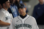 Seattle Mariners starting pitcher Yusei Kikuchi walks in the dugout after he was pulled from the team's baseball game against the Kansas City Royals during the sixth inning Thursday, Aug. 26, 2021, in Seattle. (AP Photo/Ted S. Warren)