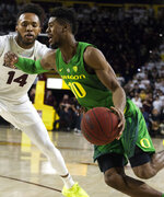Oregon's Victor Bailey Jr. (10) drives around Arizona State's Kimani Lawrence (14) during the first half of an NCAA college basketball game Saturday, Jan. 19, 2019, in Tempe, Ariz. (AP Photo/Darryl Webb)