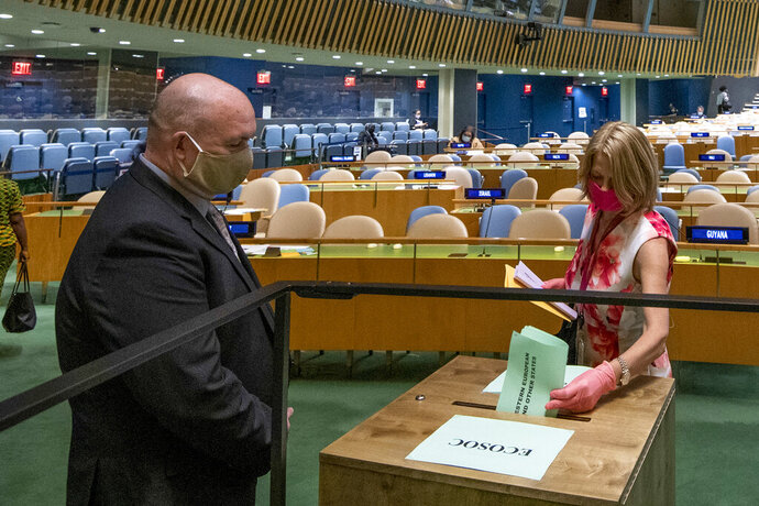 Norway's ambassador to the United Nations, Mona Juul, casts a vote during U.N. elections, Wednesday, June 17, 2020, at U.N. headquarters in New York. Norway and Ireland won contested seats on the powerful U.N. Security Council Wednesday in a series of U.N. elections held under dramatically different voting procedures because of the COVID-19 pandemic. (Eskinder Debebe/UN Photo via AP)