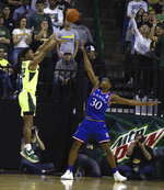 Baylor guard Jared Butler (12) shoots over Kansas guard Ochai Agbaji (30) in the first half of an NCAA college basketball game, Saturday, Jan. 12, 2019, in Waco, Texas. (AP Photo/Jerry Larson)