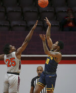 Coppin State's Koby Thomas (10) shoots over Virginia Tech's Justyn Mutts (25) during the first half of an NCAA college basketball game, Saturday, Dec. 19, 2020 in Blacksburg, Va. (Matt Gentry/The Roanoke Times via AP, Pool)