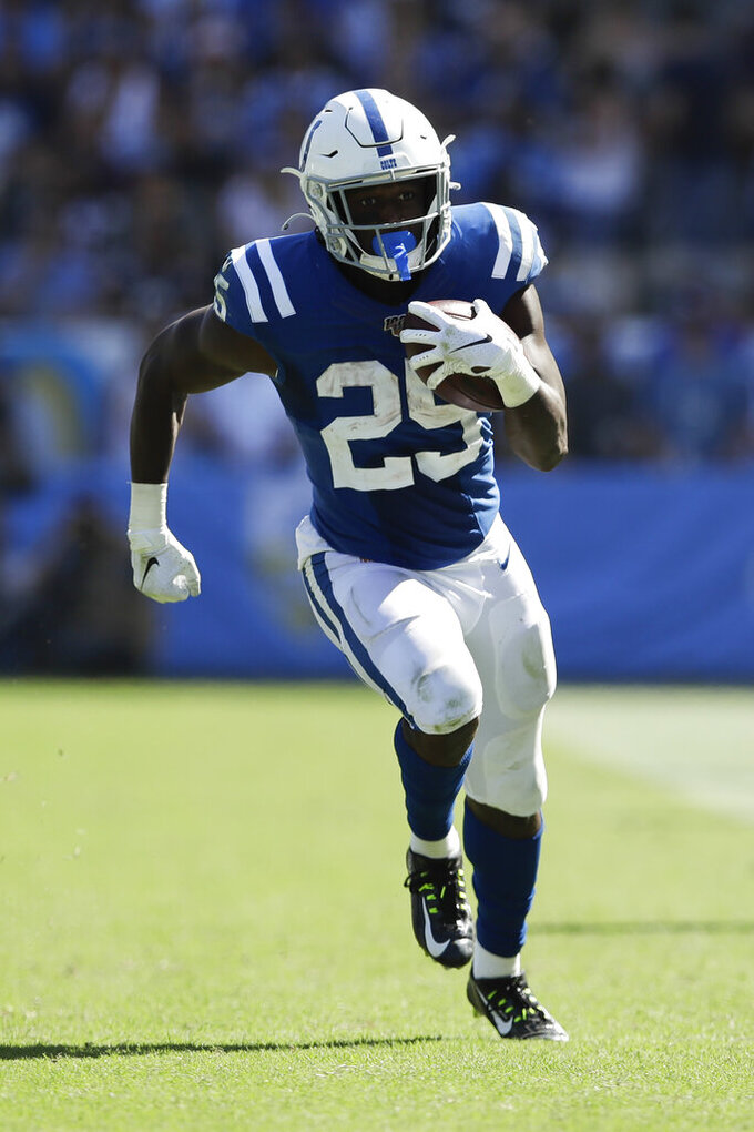Indianapolis Colts running back Marlon Mack runs for a touchdown during the second half in an NFL football game against the Los Angeles Chargers Sunday, Sept. 8, 2019, in Carson, Calif. (AP Photo/Marcio Jose Sanchez)
