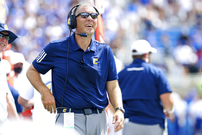 Chattanooga head coach Rusty Wright looks up at the video board during the first half of a NCAA college football game against Kentucky in Lexington, Ky., Saturday, Sept. 18, 2021. (AP Photo/Michael Clubb)
