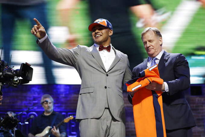 Iowa tight end Noah Fant poses with NFL Commissioner Roger Goodell after the Denver Broncos selected Fant in the first round at the NFL football draft, Thursday, April 25, 2019, in Nashville, Tenn. (AP Photo/Mark Humphrey)