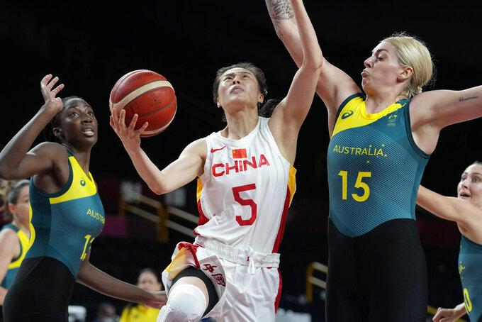 China's Siyu Wang (5) drives on Australia's Cayla George (15) during a women's basketball preliminary round game at the 2020 Summer Olympics in Saitama, Japan, Friday, July 30, 2021. (AP Photo/Eric Gay)