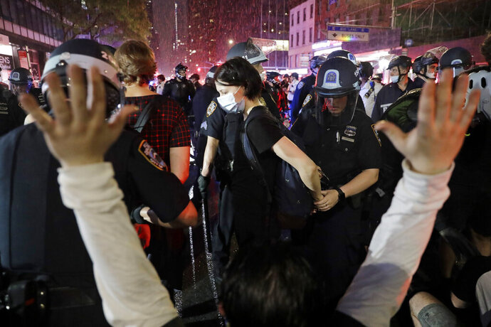 Police arrest protesters as they march through the streets of Manhattan, New York, Wednesday, June 3, 2020. New York City Mayor Bill de Blasio says that the city has taken a