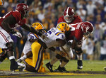 Alabama running back Damien Harris (34) carries against LSU linebacker Jacob Phillips (6) and defensive lineman Stephon Wynn Jr. (90) in the first half of an NCAA college football game in Baton Rouge, La., Saturday, Nov. 3, 2018. (AP Photo/Gerald Herbert)
