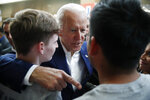Former Vice President and Democratic presidential candidate Joe Biden meets with attendees at a campaign event Saturday, Jan. 11, 2020, in Las Vegas. (AP Photo/John Locher)