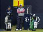 England's Lee Westwood with his caddie and girlfriend Hellen Storey wait on the 1st tee to start during the final round of the British Open Golf Championships at Royal Portrush in Northern Ireland, Sunday, July 21, 2019.(AP Photo/Matt Dunham)