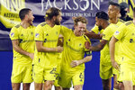 Nashville SC midfielder Dax McCarty (6) is congratulated after scoring a goal against Inter Miami during the second half of an MLS soccer playoff match Friday, Nov. 20, 2020, in Nashville, Tenn. (AP Photo/Mark Humphrey)