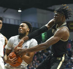 Samford guard Myron Gordon (4) secures a rebound over Wofford forward Chevez Goodwin (1) during the first half of an NCAA college basketball game Saturday, March 2, 2019, in Birmingham, Ala. (AP Photo/Julie Bennett)