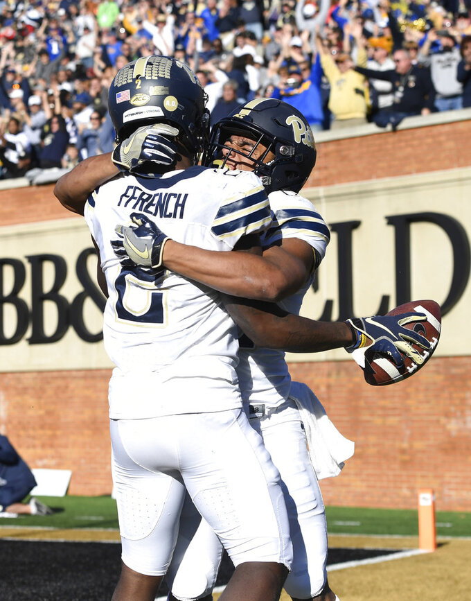 Pittsburgh'sMaurice Ffrench (2) celebrates a touchdown with Rafael Araujo-Lopes (82) during the second half of the NCAA college football game against Wake Forest Saturday, Nov. 17, 2018, in Winston-Salem, N.C. (AP Photo/Woody Marshall)