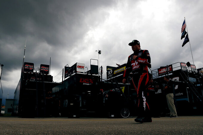 Cole Custer walks through the garage area after practice for a NASCAR Xfinity Series auto race, Saturday, June 15, 2019, at Iowa Speedway in Newton, Iowa. (AP Photo/Charlie Neibergall)
