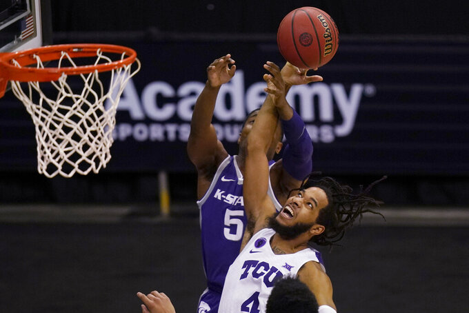 TCU guard PJ Fuller (4) knocks the ball from Kansas State guard Rudi Williams (5) during the second half of an NCAA college basketball game in the first round of the Big 12 men's tournament in Kansas City, Mo., Wednesday, March 10, 2021. (AP Photo/Orlin Wagner)