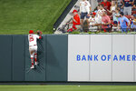 St. Louis Cardinals right fielder Dexter Fowler is unable to catch a home run hit by Oakland Athletics' Marcus Semien during the fifth inning of a baseball game Tuesday, June 25, 2019, in St. Louis. (AP Photo/Scott Kane)