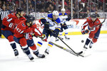 St. Louis Blues right wing Vladimir Tarasenko (91), of Russia, battles for the puck against Washington Capitals right wing Tom Wilson (43), defenseman John Carlson (74) and left wing Jakub Vrana (13) during the first period of an NHL hockey game, Monday, Jan. 14, 2019, in Washington. (AP Photo/Nick Wass)