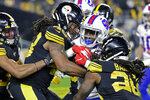 Buffalo Bills running back Devin Singletary, second from right, is stopped short of the goal line by Pittsburgh Steelers inside linebacker Mark Barron, right, outside linebacker Bud Dupree (48) and free safety Minkah Fitzpatrick, left, during the first half of an NFL football game in Pittsburgh, Sunday, Dec. 15, 2019. (AP Photo/Don Wright)