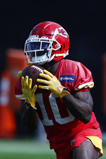 Kansas City Chiefs wide receiver Tyreek Hill (10) catches the ball during practice on Thursday, Jan. 30, 2020, in Davie, Fla., for the NFL Super Bowl 54 football game. (AP Photo/Brynn Anderson)