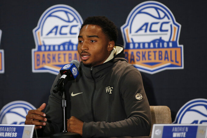 Wake Forest player Brandon Childress answers a question during the Atlantic Coast Conference NCAA college basketball media day in Charlotte, N.C., Tuesday, Oct. 8, 2019. (AP Photo/Nell Redmond)