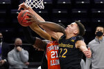 Northwestern forward Pete Nance, right, and Illinois center Kofi Cockburn vie for a rebound during the first half of an NCAA college basketball game in Evanston, Ill., Thursday, Jan. 7, 2021. (AP Photo/Nam Y. Huh)