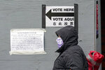 A woman wears a protective mask during the coronavirus pandemic as she stands in line for an early voting location near Lincoln Center Monday, Oct. 26, 2020, in New York. Early voting ahead of the Nov. 3 general election continued for the second day in New York state. (AP Photo/Frank Franklin II)