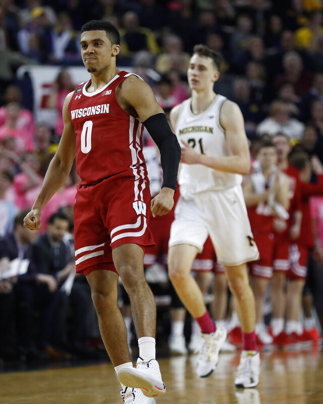 Wisconsin guard D'Mitrik Trice (0) reacts after making a 3-point basket during the second half of the team's NCAA college basketball game against Michigan, Thursday, Feb. 27, 2020, in Ann Arbor, Mich. (AP Photo/Carlos Osorio)