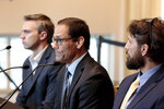 Mike Schyck, center, speaks along with Brian Garrett, left, and Dan Ritchie, right, during a meeting of the Ohio State University Board of Trustees on Thursday, Nov. 21, 2019, at the Longaberger Alumni House in Columbus, Ohio. The three men were all victims of Dr. Richard Strauss, a former Ohio State University team doctor who sexually abused athletes and other young men throughout his two decades at the school. (Joshua A. Bickel/The Columbus Dispatch via AP)
