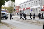 Police officers run to the Perm State University in Perm, about 1,100 kilometers (700 miles) east of Moscow, Russia, Monday, Sept. 20, 2021. A gunman opened fire in a university in the Russian city of Perm on Monday morning, leaving around eight people dead and others wounded, according to Russia's Investigative Committee. (AP Photo/Anastasia Yakovleva)