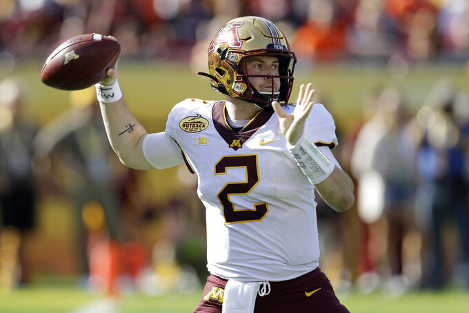 FILE  - In this Wednesday, Jan. 1, 2020, file photo, Minnesota quarterback Tanner Morgan (2) throws a pass against Auburn during the first half of the Outback Bowl NCAA college football game, in Tampa, Fla. Minnesota is scheduled to begin their season against Michigan on Oct. 24. (AP Photo/Chris O'Meara, File)