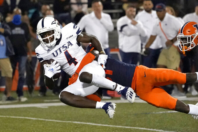 UTSA's Zakhari Franklin (4) catches a pass from quarterback Frank Harris as Illinois defensive back Devon Witherspoon (31) defends during the first half of an NCAA college football game Saturday, Sept. 4, 2021, in Champaign, Ill. (AP Photo/Charles Rex Arbogast)