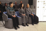 Rao Jiping, left, and her brother Rao Jian, far right, listen with their translator Caroline Chen during a ceremony at the Associated Press headquarters in New York, Wednesday, Dec. 11, 2019, honoring their father Y.C. Jao for his service as a Chinese correspondent working for the AP in China at the time of the Communist Red Army's victory over Nationalist forces and its conquest of China. Jao continued to work for AP in Nanjing even after American correspondents were evicted from the country. His passion for journalism led to his execution in 1951. (AP Photo/ Chuck Zoeller)