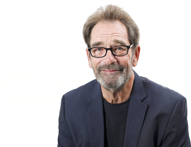 FILE - This Oct. 2, 2019 file photo shows musician Huey Lewis posing for a portrait in New York. The 69-year-old frontman for Huey Lewis & The News has a new album