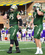 William & Mary's Bill Murray (95) and Carl Fowler (9) walk off the field in frustration after giving up a touchdown to James Madison during an NCAA college football game in Williamsburg, Va., on Saturday, Oct. 19, 2019. (Mike Caudill/The Virginian-Pilot via AP)