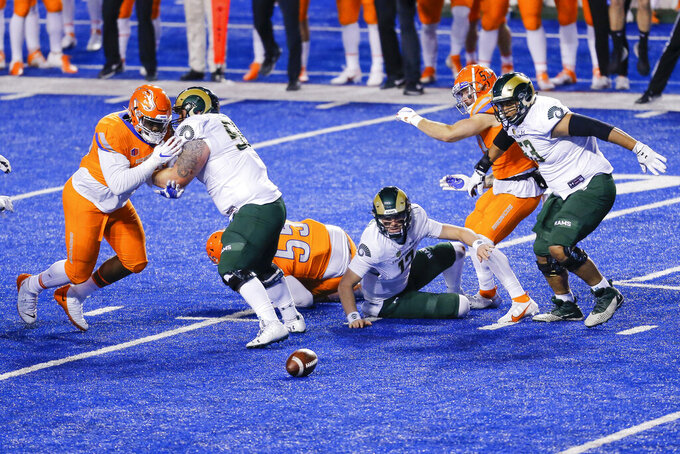 Colorado State quarterback Patrick O'Brien (12) scrambles on the ground after fumbling the ball during the first half of the team's NCAA college football game against Boise State on Thursday, Nov. 12, 2020, in Boise, Idaho. (AP Photo/Steve Conner)