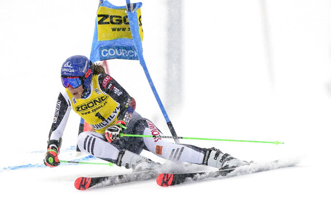 Slovakia's Petra Vlhova speeds down the course during an alpine ski, women's World Cup giant slalom in Courchevel, France, Saturday, Dec. 12, 2020. (AP Photo/Giovanni Auletta)