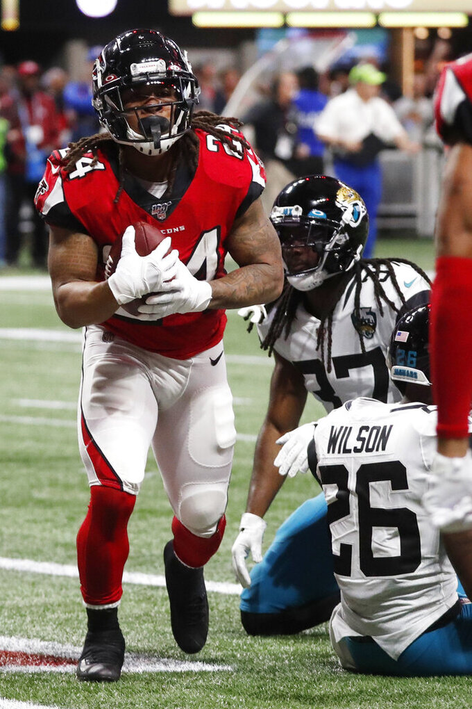 Atlanta Falcons running back Devonta Freeman (24) celebrates in the end zone for a touchdown against the Jacksonville Jaguars during the first half of an NFL football game, Sunday, Dec. 22, 2019, in Atlanta. (AP Photo/John Bazemore)