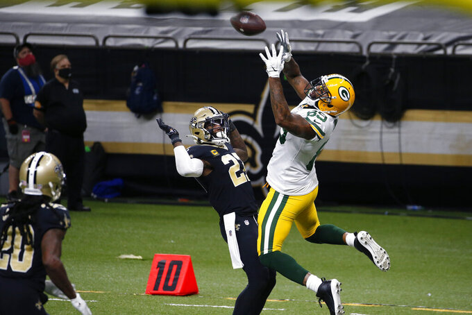 Green Bay Packers tight end Marcedes Lewis (89) pulls in a touchdown reception in front of New Orleans Saints strong safety Malcolm Jenkins (27) in the second half of an NFL football game in New Orleans, Sunday, Sept. 27, 2020. (AP Photo/Butch Dill)