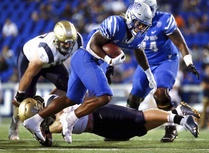 Memphis running back Brandon Thomas (22) dodges a Navy defender during an NCAA college football game Thursday, Oct. 14, 2021, in Memphis, Tenn. (Patrick Lantrip/Daily Memphian via AP)