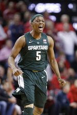 FILE - In this Jan. 17, 2019, file photo, Michigan State's Cassius Winston (5) reacts after scoring a 3-point shot during the first half of an NCAA college basketball game against Nebraska, in Lincoln, Neb. Cassius Winston is the unanimous pick for Big Ten Preseason Player of the Year. The vote by media announced Wednesday, Oct. 2, 2019, was hardly a surprise considering Winston was selected Big Ten Player of the Year last season. (AP Photo/Nati Harnik, File)