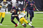 Houston Texans quarterback Deshaun Watson (4) runs with the ball as Green Bay Packers safety Vernon Scott (36) defends during the second half of an NFL football game Sunday, Oct. 25, 2020, in Houston. (AP Photo/Eric Christian Smith)