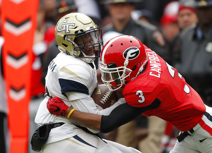 Georgia Tech quarterback James Graham (4) is tackled by Georgia defensive back Tyson Campbell (3) after a catch in the second half an NCAA college football game Saturday, Nov. 24, 2018, in Athens, Ga. Georgia won 45-21. (AP Photo/John Bazemore)